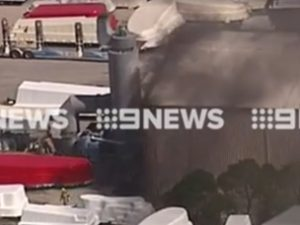 Firefighters battle the fire inside the Narellan Pools factory at Staplyton. Image: 9 News Gold Coast
