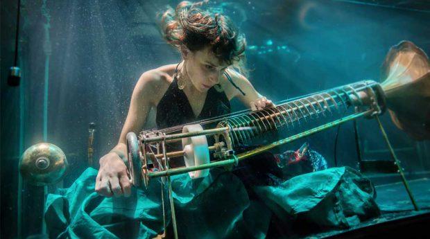 Nanna Bech of Aquasonic performing in an aquarium. Photo Credit: Charlotta de Miranda